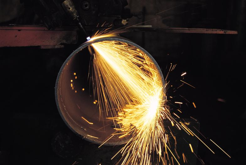 sparks flying from metal cutting torch